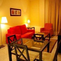 Отель Apartamentos Luxsevilla Palacio Испания, Севилья - отзывы, цены и фото номеров - забронировать отель Apartamentos Luxsevilla Palacio онлайн комната для гостей фото 4
