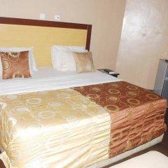 Отель Emglo Suites комната для гостей фото 3