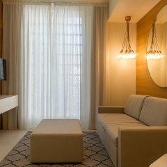 Отель Metropol Ceccarini Suite Риччоне комната для гостей фото 8