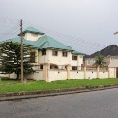 Отель Michelle Suites Нигерия, Калабар - отзывы, цены и фото номеров - забронировать отель Michelle Suites онлайн вид на фасад