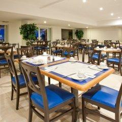 Отель Holiday Inn Cancun Arenas Мексика, Канкун - отзывы, цены и фото номеров - забронировать отель Holiday Inn Cancun Arenas онлайн питание фото 4