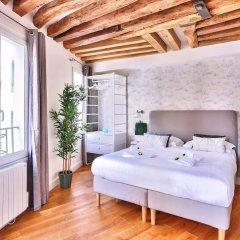 Апартаменты Amazing Apartment Close to Notre Dame Париж комната для гостей фото 2
