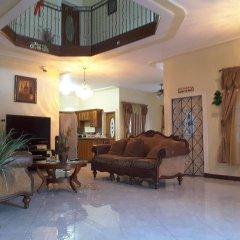 Отель Cazwin Villas Ямайка, Монтего-Бей - отзывы, цены и фото номеров - забронировать отель Cazwin Villas онлайн интерьер отеля