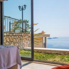 Villa Roza by Akdenizvillam Турция, Калкан - отзывы, цены и фото номеров - забронировать отель Villa Roza by Akdenizvillam онлайн пляж