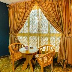 Отель Dana Al Buhairah Hotel ОАЭ, Шарджа - отзывы, цены и фото номеров - забронировать отель Dana Al Buhairah Hotel онлайн удобства в номере фото 2