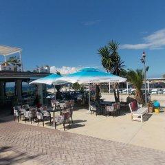 Отель Sunset Suites Албания, Саранда - отзывы, цены и фото номеров - забронировать отель Sunset Suites онлайн пляж фото 2
