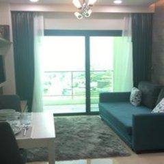 Отель Dusit Grand Condo View Pattaya Паттайя комната для гостей фото 3