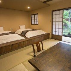 Отель Ryokan Ichinoi Минамиогуни комната для гостей
