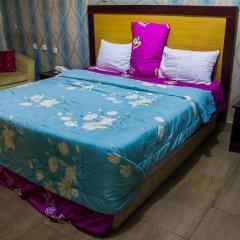 Отель Emglo Suites комната для гостей фото 4