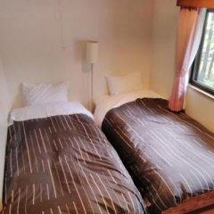 Отель Pension Piremon Хакуба комната для гостей