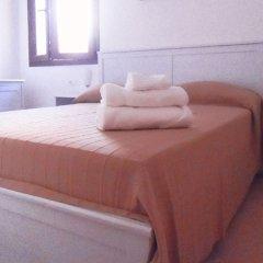 Отель Appartamenti Castelsardo Кастельсардо комната для гостей