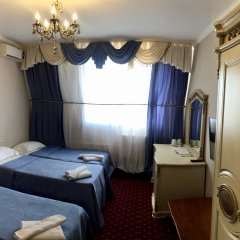 Гостиница Гранд Уют 4* Стандартный семейный номер разные типы кроватей фото 2