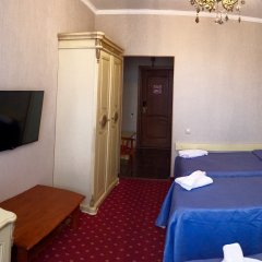 Гостиница Гранд Уют 4* Стандартный семейный номер разные типы кроватей