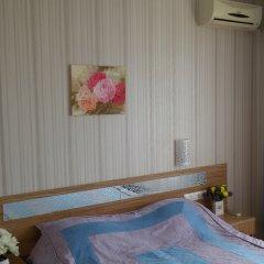 Апартаменты Семейный номер с видом на море комната для гостей фото 2