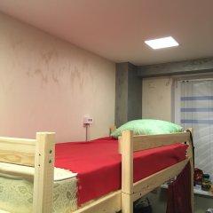 Хостел Аквариум Кровать в общем номере с двухъярусными кроватями