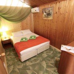 Мини-отель Банановый рай Люкс с разными типами кроватей