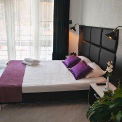 Гостиница Гостевой дом AMIGO Ольгинка в Ольгинке отзывы, цены и фото номеров - забронировать гостиницу Гостевой дом AMIGO Ольгинка онлайн комната для гостей фото 3