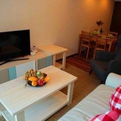 Апартаменты The Title Condotel комната для гостей