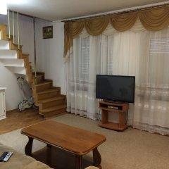 Апартаменты Двухуровневые Апартаменты на Тютинников комната для гостей фото 2