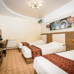 Гостиница Астра комната для гостей фото 9