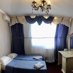 Гостиница Гранд Уют 4* Стандартный семейный номер разные типы кроватей фото 3