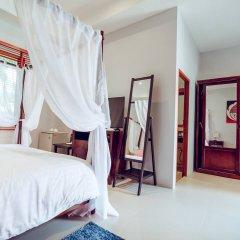 Отель Villa Laguna Phuket 4* Улучшенный номер с различными типами кроватей фото 9