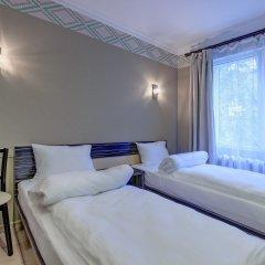 Гостиница Resident Almaty Алматы комната для гостей фото 5