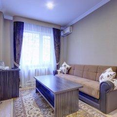 Гостиница Resident Almaty Алматы комната для гостей фото 2