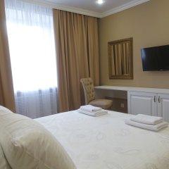 Апартаменты КвартХаус комната для гостей фото 2