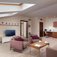 Гостиница Hilton Garden Inn Kaluga в Калуге - забронировать гостиницу Hilton Garden Inn Kaluga, цены и фото номеров Калуга комната для гостей