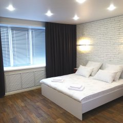 Апартаменты КвартХаус комната для гостей фото 4