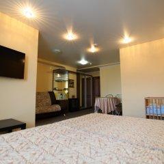 Гостиница Два крыла Стандартный семейный номер с различными типами кроватей фото 12