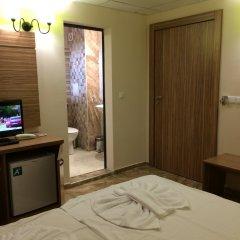 TM Deluxe Hotel удобства в номере