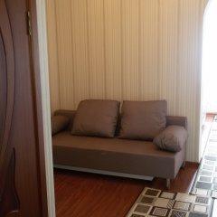 Апартаменты Семейный номер с видом на море комната для гостей фото 4