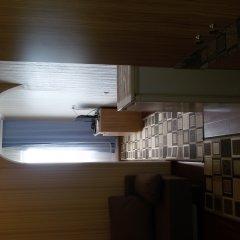 Апартаменты Семейный номер с видом на море интерьер отеля фото 2
