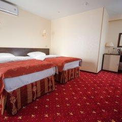 Амакс Сафар отель комната для гостей фото 10
