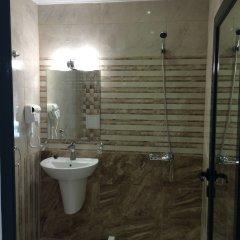 TM Deluxe Hotel ванная