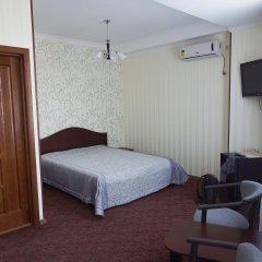 Гостиница Мини-отель OSKAR в Симферополе - забронировать гостиницу Мини-отель OSKAR, цены и фото номеров Симферополь комната для гостей фото 4
