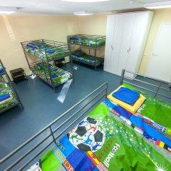Хостел Чемпион Кровать в общем номере с двухъярусной кроватью