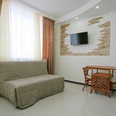 Апартаменты Лотос комната для гостей фото 2