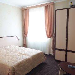 Гостиница Мини-отель OSKAR в Симферополе - забронировать гостиницу Мини-отель OSKAR, цены и фото номеров Симферополь комната для гостей фото 2