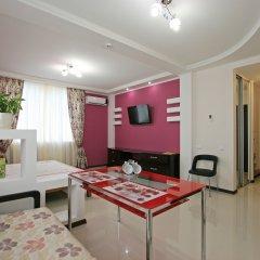 Апартаменты Лотос комната для гостей фото 4