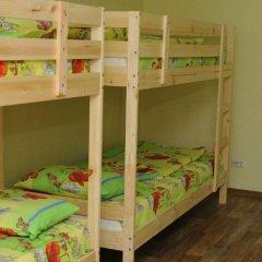 Хостел Как Дома Кровати в общем номере с двухъярусными кроватями