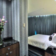 Отель The Continent Bangkok by Compass Hospitality 4* Улучшенный номер с различными типами кроватей фото 12