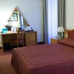 Отель NH Milano Touring 4* Стандартный номер разные типы кроватей фото 27