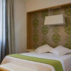 Отель NH Milano Touring 4* Улучшенный номер разные типы кроватей фото 46