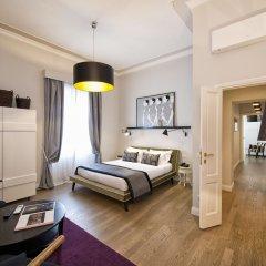 Отель The Independent Suites Стандартный номер с различными типами кроватей