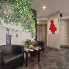 Отель Timhotel Montmartre Париж лобби