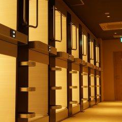 Tokyo Ekimae BAY HOTEL Капсула в мужском общем номере