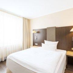 Отель NH Collection Berlin Mitte Am Checkpoint Charlie 4* Стандартный номер с разными типами кроватей фото 16